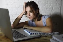 Young student girl studying tired at home laptop computer preparing exam exhausted and frustrated feeling stress royalty free stock images