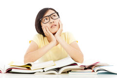 Young student girl thinking with book on the desk Stock Photo
