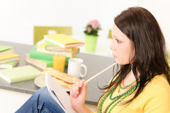 Young student girl thinking in kitchen Royalty Free Stock Photos