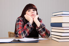 Young student girl tired taking a homework break Royalty Free Stock Photography