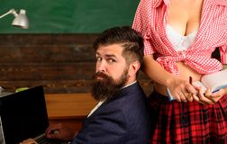 Free Young Student Girl With Sexy Bust Is Tempting A Professor. Hidden Desire Of Young Coach. Sexy Student Girl Passing An Royalty Free Stock Photo - 168322725
