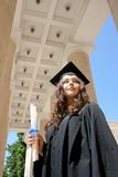 Young student in gown near the university Royalty Free Stock Photo