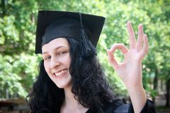 Young student in gown with okay royalty free stock image