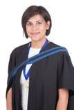 Young student graduate. Young student graduating with black robe Stock Photos