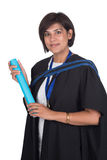 Young student graduate with scroll. Young student graduating with robe and scroll Royalty Free Stock Photo