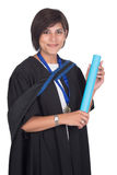Young student graduate with scroll. Young student graduating with robe and scroll Stock Photo