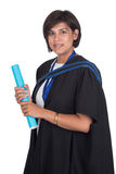 Young student graduate with scroll. Young student graduating with robe and scroll Stock Images