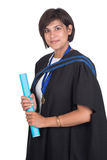 Young student graduate with scroll. Young student graduating with robe and scroll Royalty Free Stock Photos