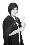 Young student graduate with scroll. Young student graduating with robe and scroll black and white Royalty Free Stock Photography