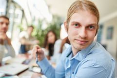 Young student in group work stock image