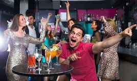 Young student guy is dancing on party. In the bar Stock Photo