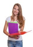 Young student hands out her paperwork Royalty Free Stock Photos
