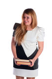 The young student with a heap of textbooks smiles Royalty Free Stock Image