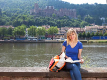 Young student in Heidelberg reading a book Royalty Free Stock Photography