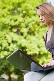 Young student with her laptop outdoors. Stock Images