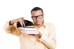 A young student holding books in one hand and an empty wallet in other Stock Image