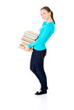 Young student holding heavy books Stock Photos