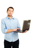 Young student holding laptop. Young student standing with laptop. Isolated on white Royalty Free Stock Photo