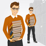 Young student holding stack of books Royalty Free Stock Photography