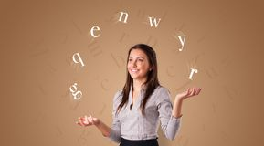 Person juggle with letters royalty free stock photo