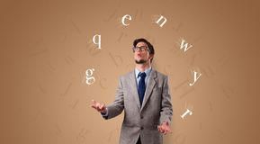 Person juggle with letters royalty free stock image
