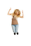 Young student jumping with thumbs up Royalty Free Stock Images