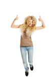 Young student jumping with thumbs up Royalty Free Stock Photo