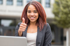 Young Student with Laptop Showing Thumbs up Royalty Free Stock Photography