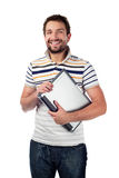 Young student with laptop smiling Royalty Free Stock Photos