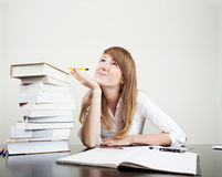 Young student learn and dream. Young woman learning and dreaming with books on table Royalty Free Stock Photos