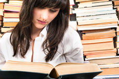 Young student learning from a book Royalty Free Stock Photography