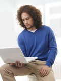 Young student learning on laptop at home Royalty Free Stock Photo