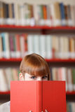 Young student in a library Stock Images