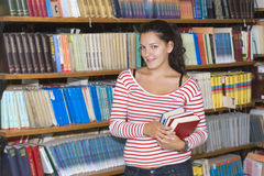 Young student in library Royalty Free Stock Photos