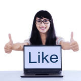 Young student with like button Stock Photo