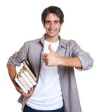 Young student likes books Royalty Free Stock Photo