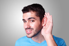 Young student listen by ear Royalty Free Stock Image