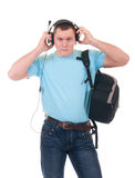 Young student listening to music. On headphone over a white background stock photo