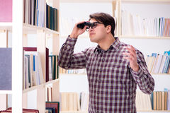 The young student looking for books in college library. Young student looking for books in college library Stock Photos