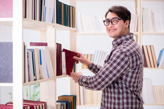 The young student looking for books in college library. Young student looking for books in college library Stock Photography