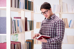 The young student looking for books in college library. Young student looking for books in college library Stock Image