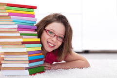 Young student with lots of books smiling Royalty Free Stock Images
