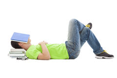 Young student lying on the floor Royalty Free Stock Photography