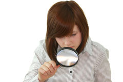 Young student with magnifier Stock Photo