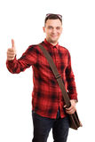 Young student making a thumbs up. A portrait of a male student with a shoulderbag giving a thumbs up, isolated on white background Stock Photos