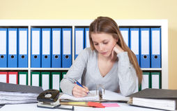 Young student at office writing a message Royalty Free Stock Image