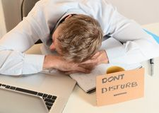 Young Student Overwhelmed sleeping Dont Disturb sign Stock Photography