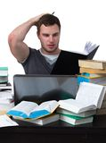 Young Student overwhelmed with studying. With piles of books in front of him Stock Images