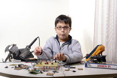 Young student performs experiments Stock Images