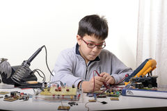 Young student performs experiments Royalty Free Stock Images